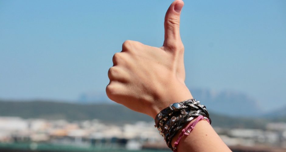 Thumbs up with positivity